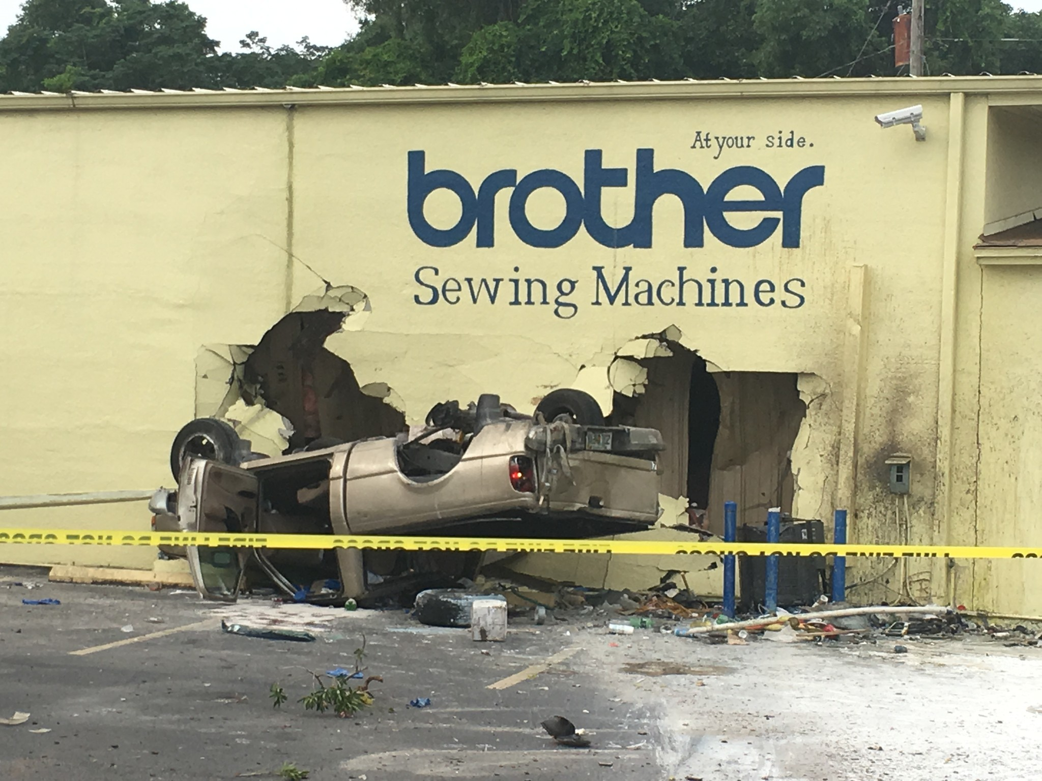 Pickup flips, crashes through building in Maitland - Orlando Sentinel
