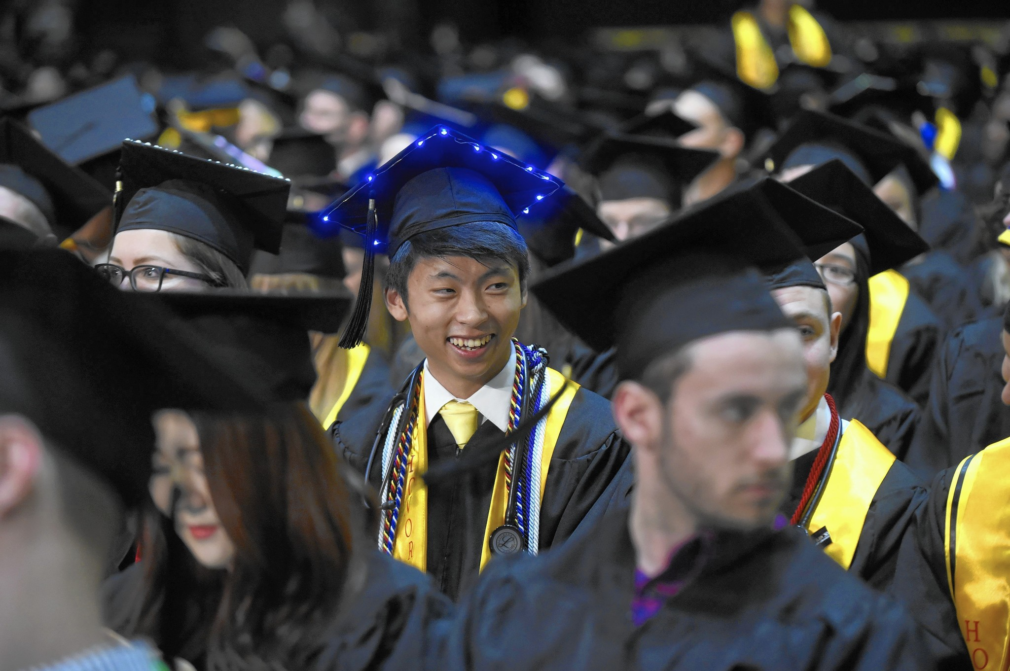 Harvard president tells UMBC grads about growing divide between ...