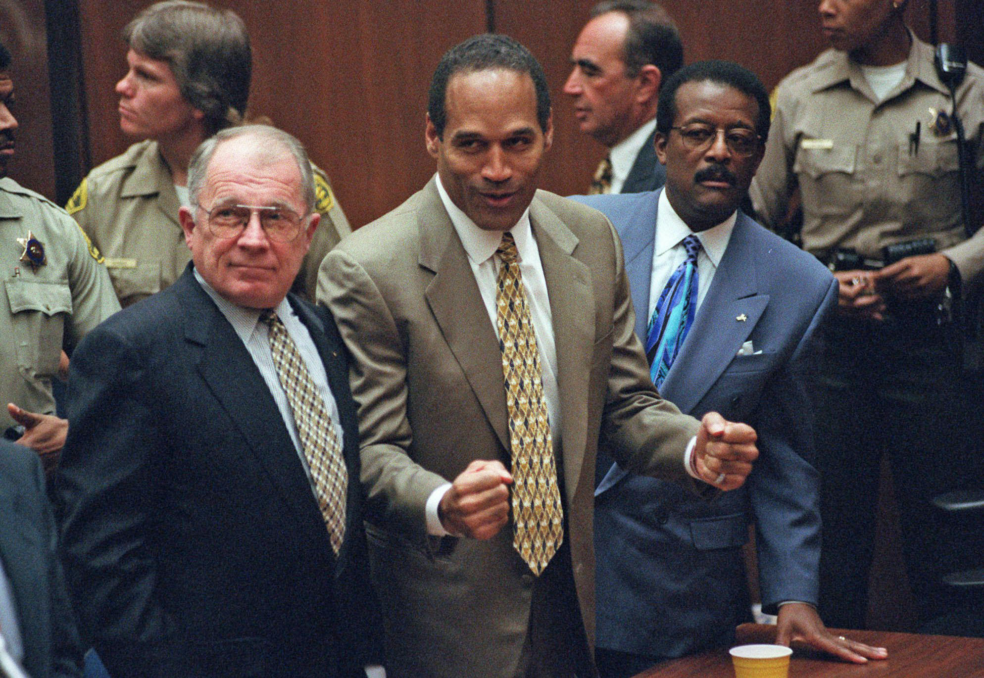 The moment O.J. Simpson, flanked by F. Lee Bailey, left and Johnnie Cochran, heard the verdict in his 1995 murder trial.