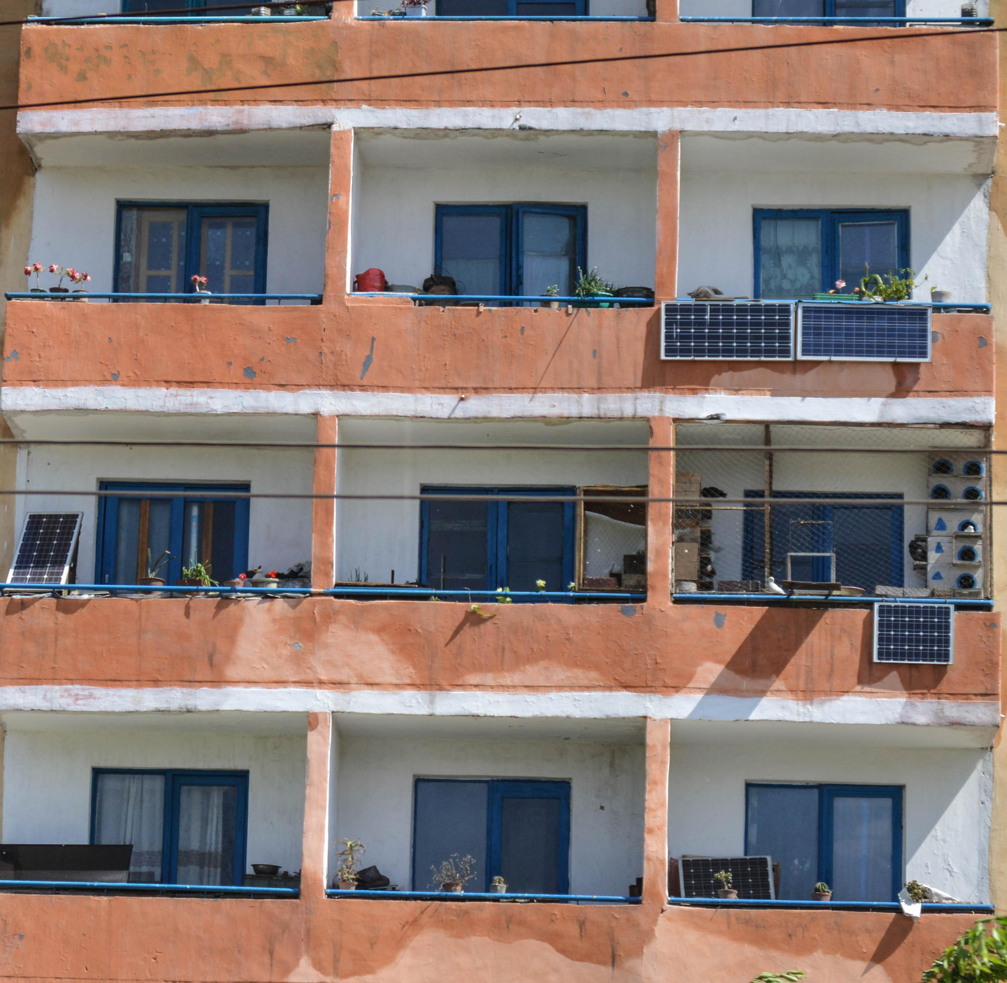 Solar panels seen on individual balconies at an apartment building in Pyongyang, North Korea.