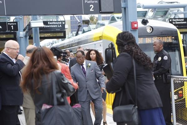 Los Angeles Supervisor Mark Ridley-Thomas, center, arrives on the Metro Expo Line in downtown Santa Monica. (Genaro Molina / Los Angeles Times)