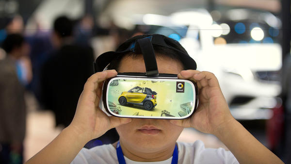 A virtual reality presentation in Beijing on April 26. (Mark Schiefelbein / Associated Press)