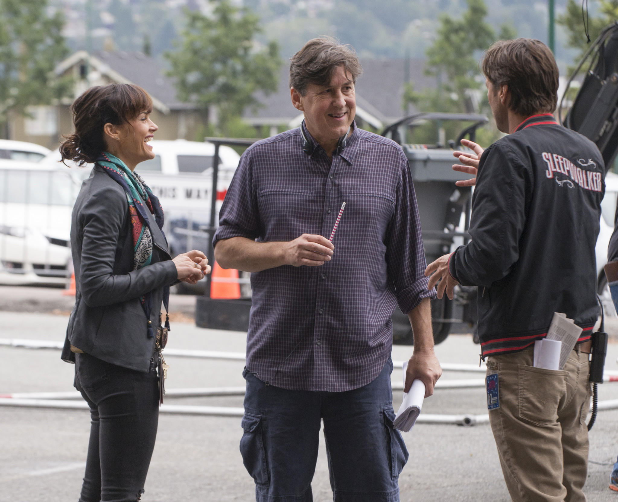 "Carla Gugino, left, Cameron Crowe and Luke Wilson behind the scenes on ""Roadies."""