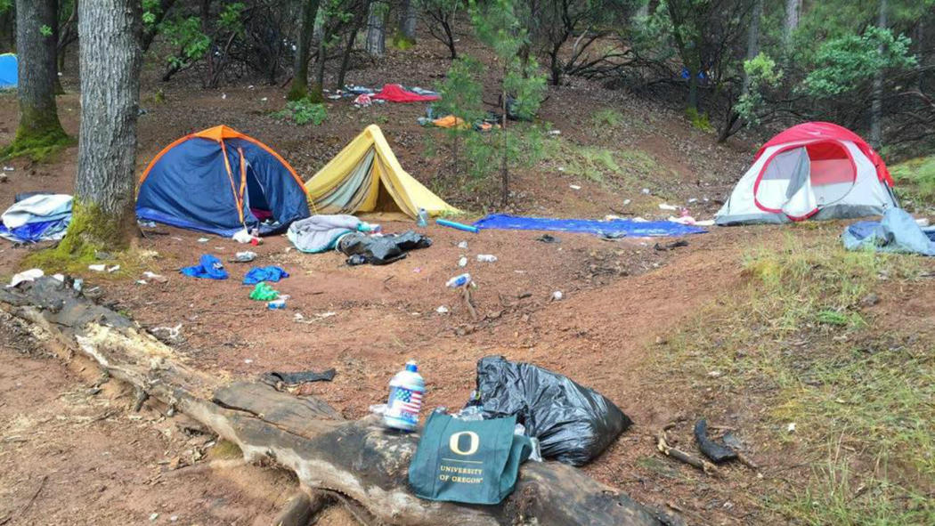 Tents and trash left behind at a Shasta Lake campsite in May 2016 are shown.