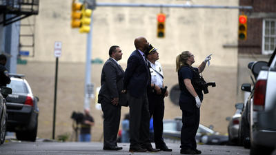 Baltimore police investigate scene of cookout shooting