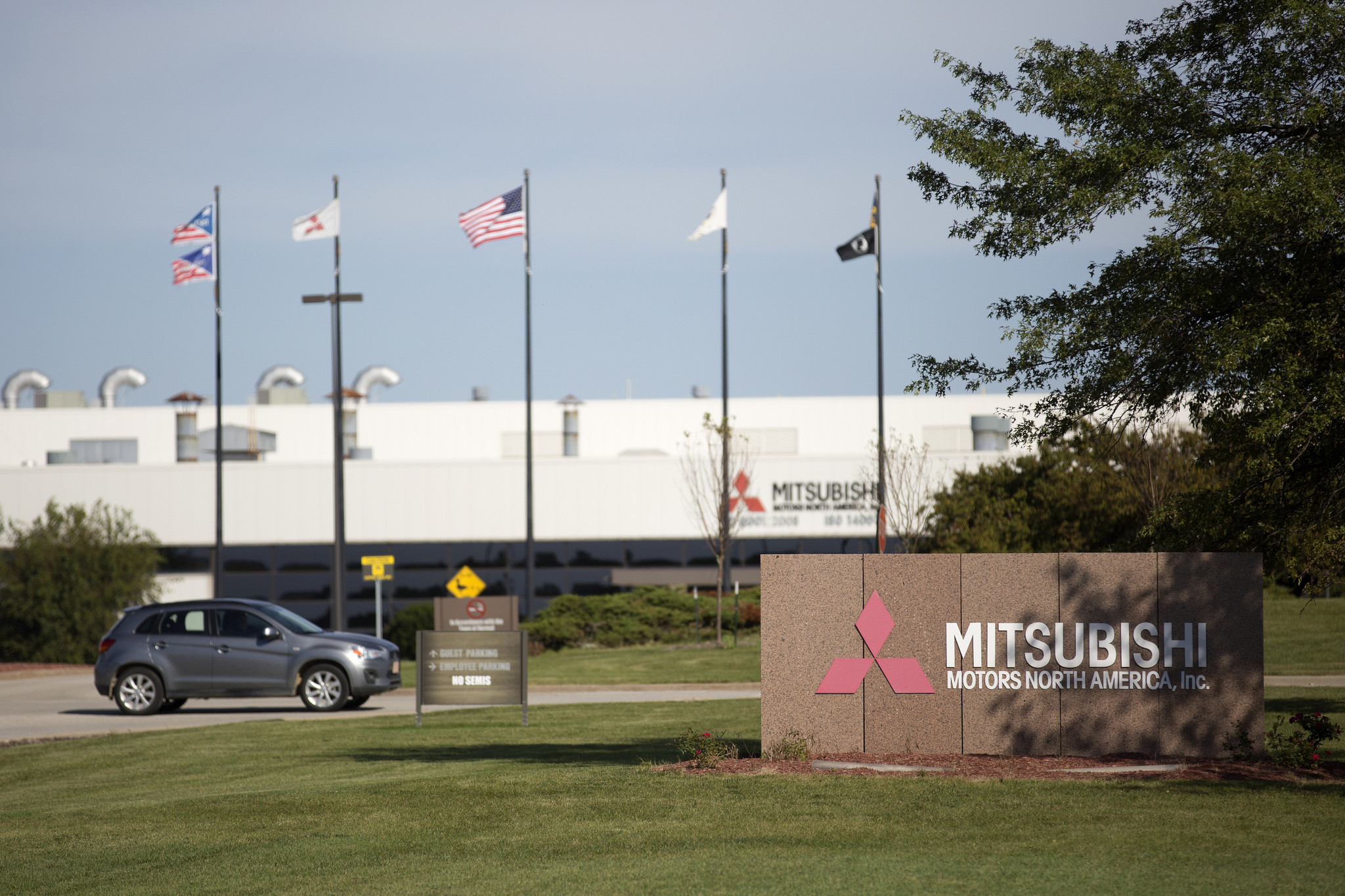 final workers finish shifts at mitsubishi plant in normal