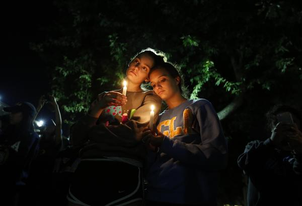 Aly Dembry, 18, an aerospace engineering student, and Rebecca Hambalek, 20, a pre-psychology student, joined hundreds of others at UCLA for a candlelight vigil. (Barbara Davidson/Los Angeles Times)