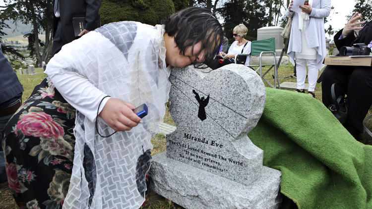 More than 100 people attended a ceremony for the girl's reburial in Colma, less than 10 miles from where she was originally buried. They christened her 'Miranda Eve.'