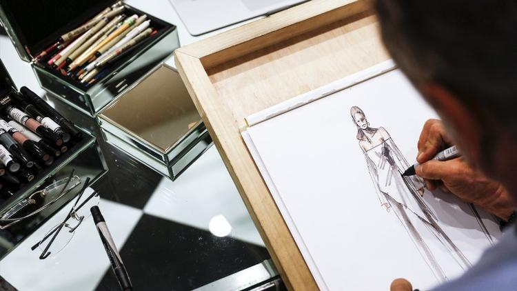 Couturier Mark Zunino sketches a design in his Beverly Hills showroom in March.