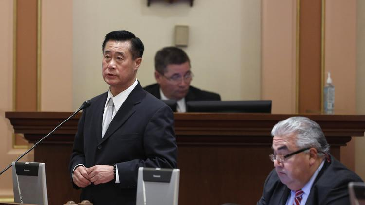 Former state Sens. Leland Yee, left, and Ronald Calderon in the Senate chambers before they were charged with crimes and suspended with pay. (Rich Pedroncelli / Associated Press)