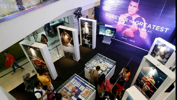 "Filipino fans look at memorabilia from the ""Thrilla in Manila"" fight between Muhammad Ali and Joe Frazier at the launch of an exhibit at the Ali Mall in Manila. (Bullit Marquez / Associated Press)"