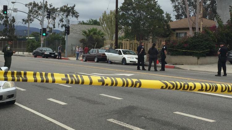 Police surround Acura in Santa Monica
