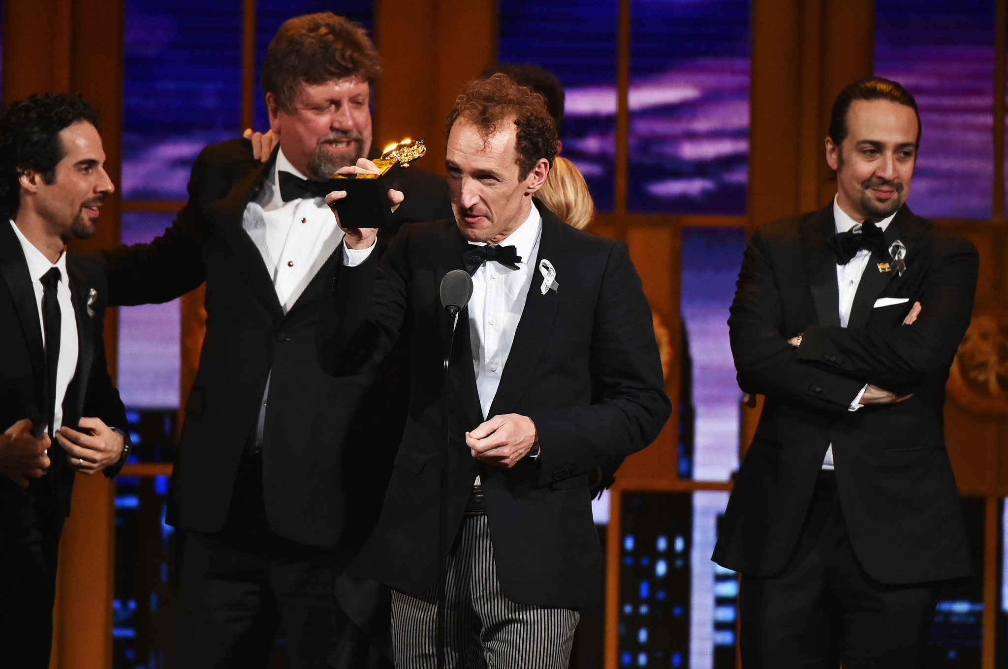 "Producer Jeffrey Seller, center, accepts the Tony Award for best musical, presented to ""Hamilton."" (Theo Wargo / Getty Images for Tony Awards Productions)"