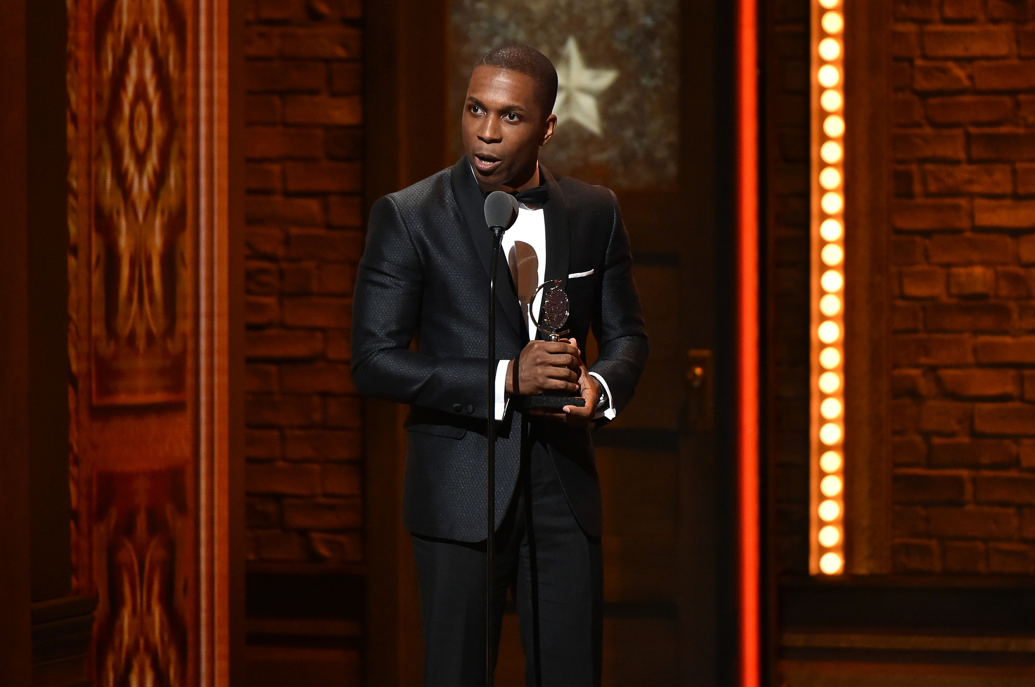 "Actor Leslie Odom Jr. accepts the award for Best Performance by an Actor in a Leading Role in a Musical in ""Hamilton"" onstage during the 70th Annual Tony Awards at The Beacon Theatre on June 12 in New York City. (Theo Wargo / Getty Images for Tony Awards Productions)"