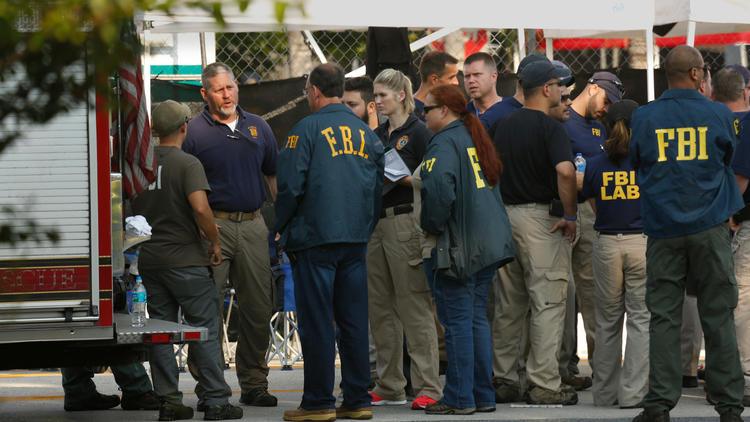FBI investigators gather Monday morning outside of Pulse nightclub in Orlando, Fla. (Carolyn Cole / Los Angeles Times)