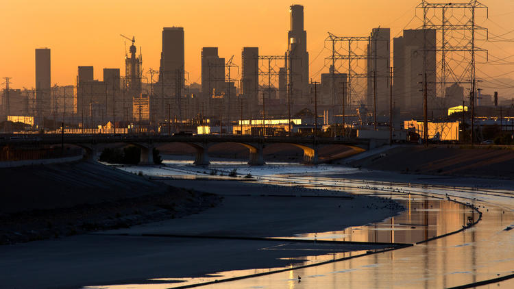 A view toward downtown Los Angeles shows the L.A. River in Maywood, Calif., on Sept. 30, 2015.