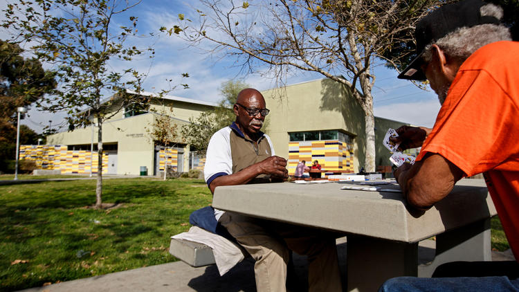 Men play pinochle at Fred Roberts Recreation Center in South Los Angeles, an area that is among the most park-poor parts of L.A. County. (Ricardo DeAratanha / Los Angeles Times)