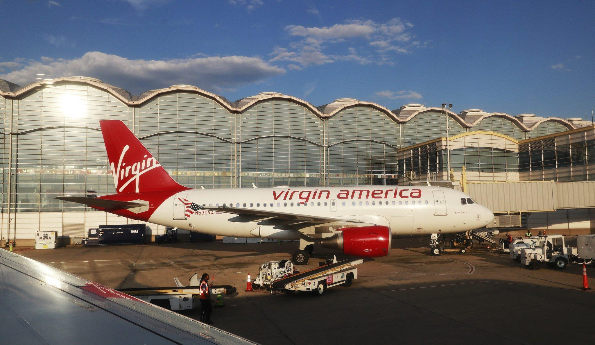 http://www.trbimg.com/img-5765749a/turbine/la-fi-travel-briefcase-virgin-20160618-snap