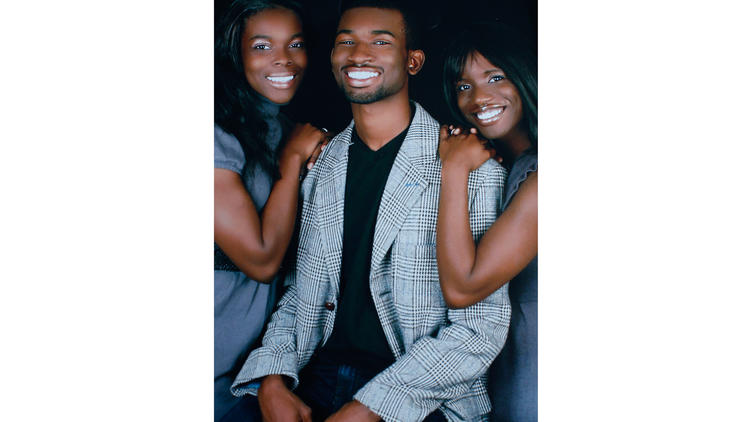 A photo of Reginald Murray and his sisters.