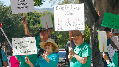 People rally in front of the San Luis Obispo County government building in support of the Diablo Canyon nuclear power plant in San Luis Obispo on March 17, 2016.