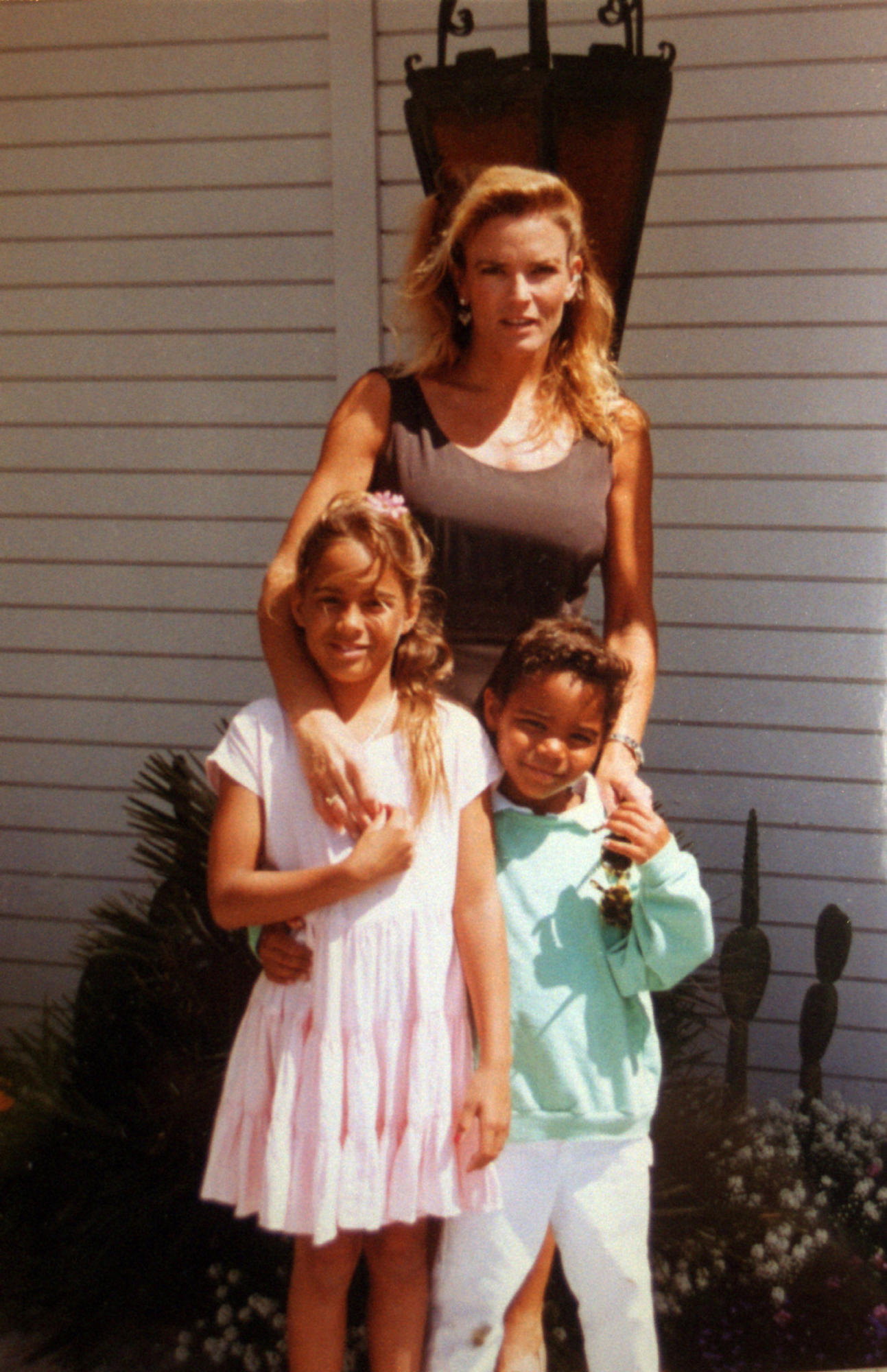 Nicole Brown Simpson with daughter Sydney and son Justin outside her parents' home.