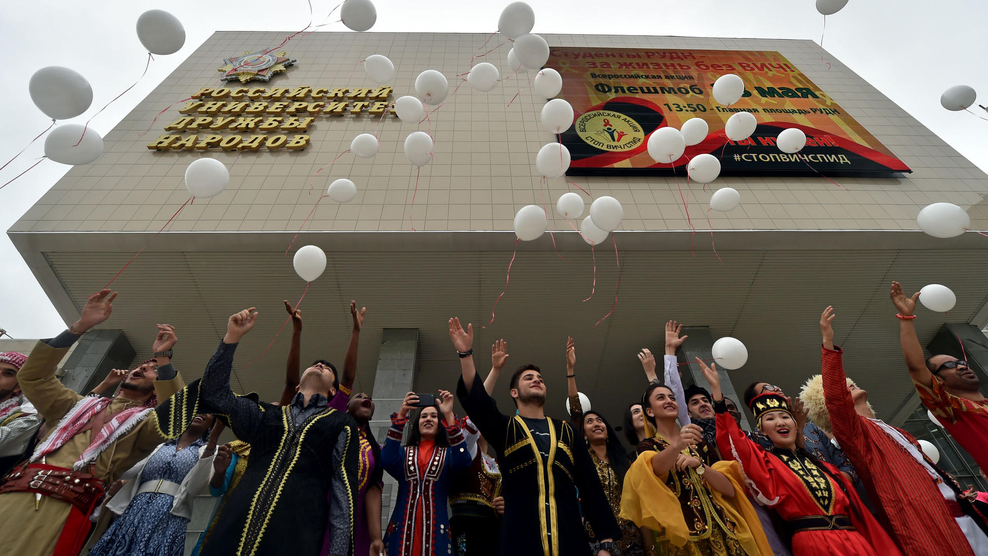 Students wearing traditional outfits release white balloons during an HIV/AIDS awareness rally in at the University of Peoples' Friendship in Moscow in May.