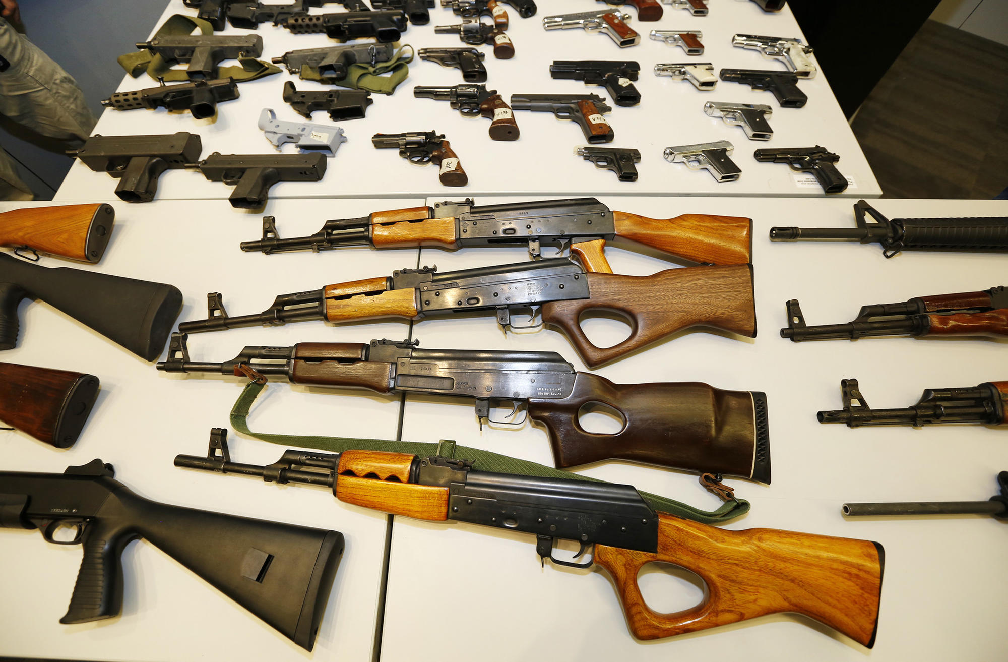 The Los Angeles Police Department displays weapons collected during a daylong gun buyback program in May.