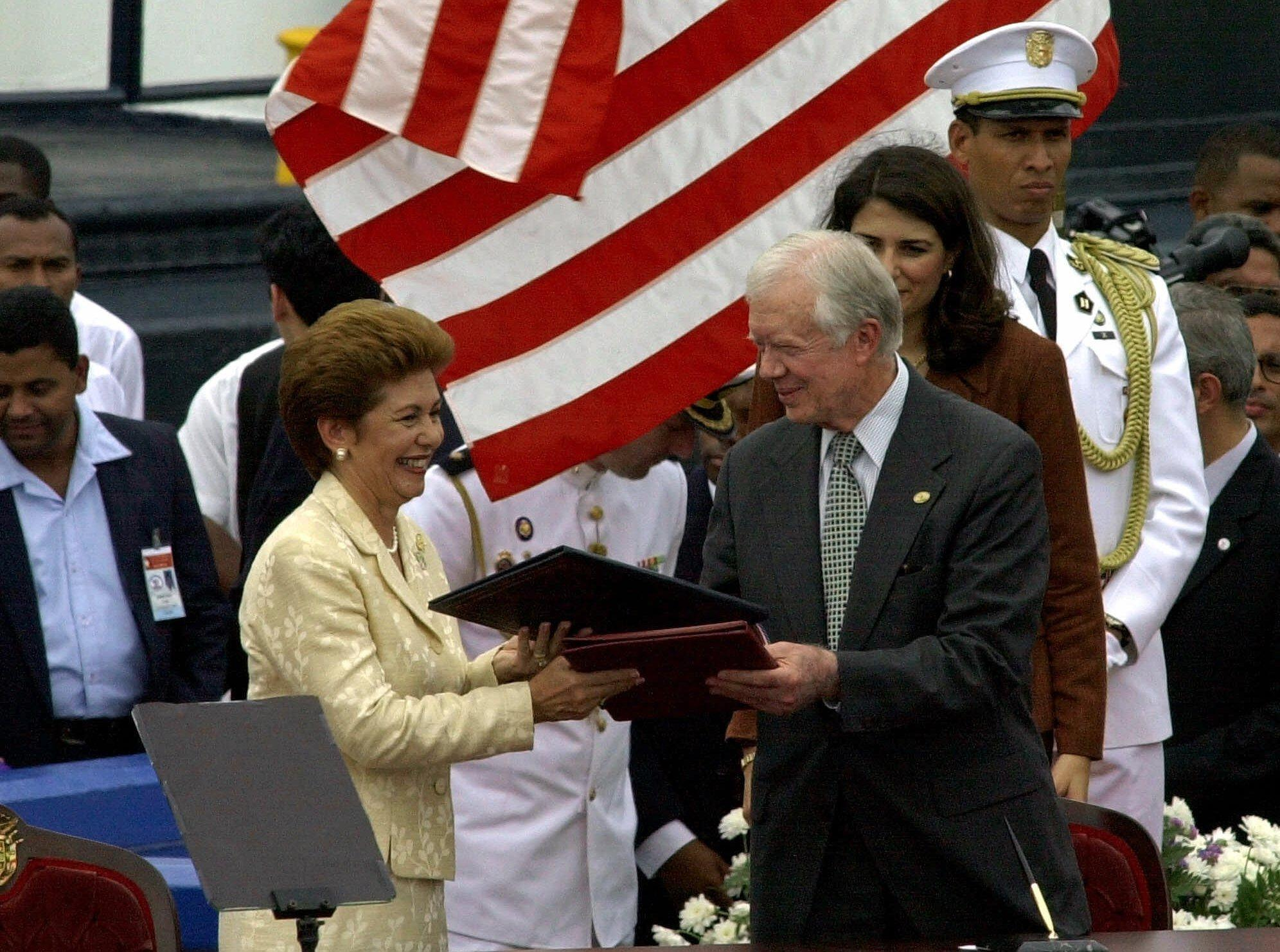 Former U.S. President Jimmy Carter with Panamanian President Mireya Moscoso during a ceremony to transfer control of the Panama Canal on Dec. 14, 1999.
