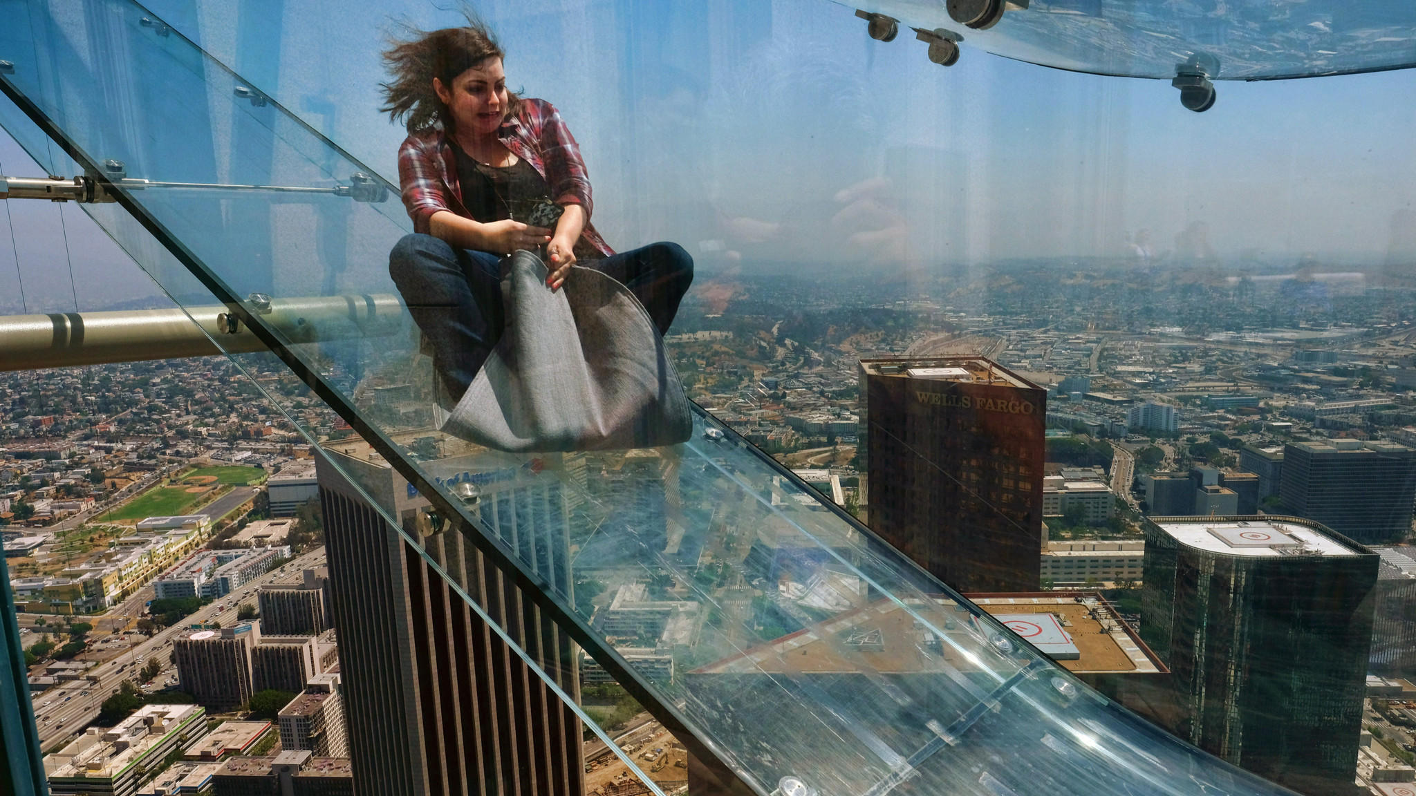 What's it like to ride a glass slide 1,000 feet above L.A ...