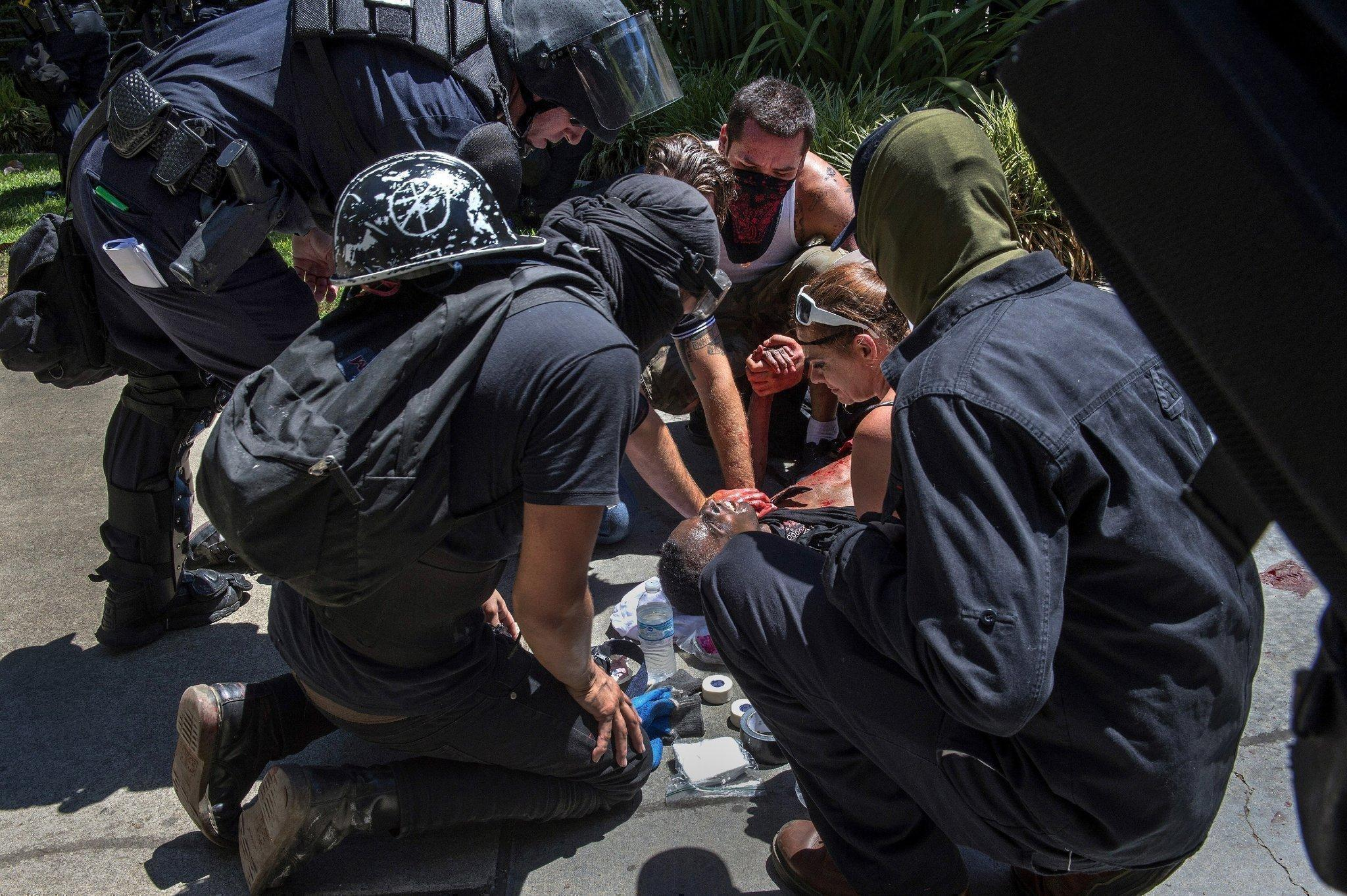 A victim is attended to after he was stabbed during a rally at the Capitol in Sacramento on Sunday. (Renee C. Byer / Associated Press)