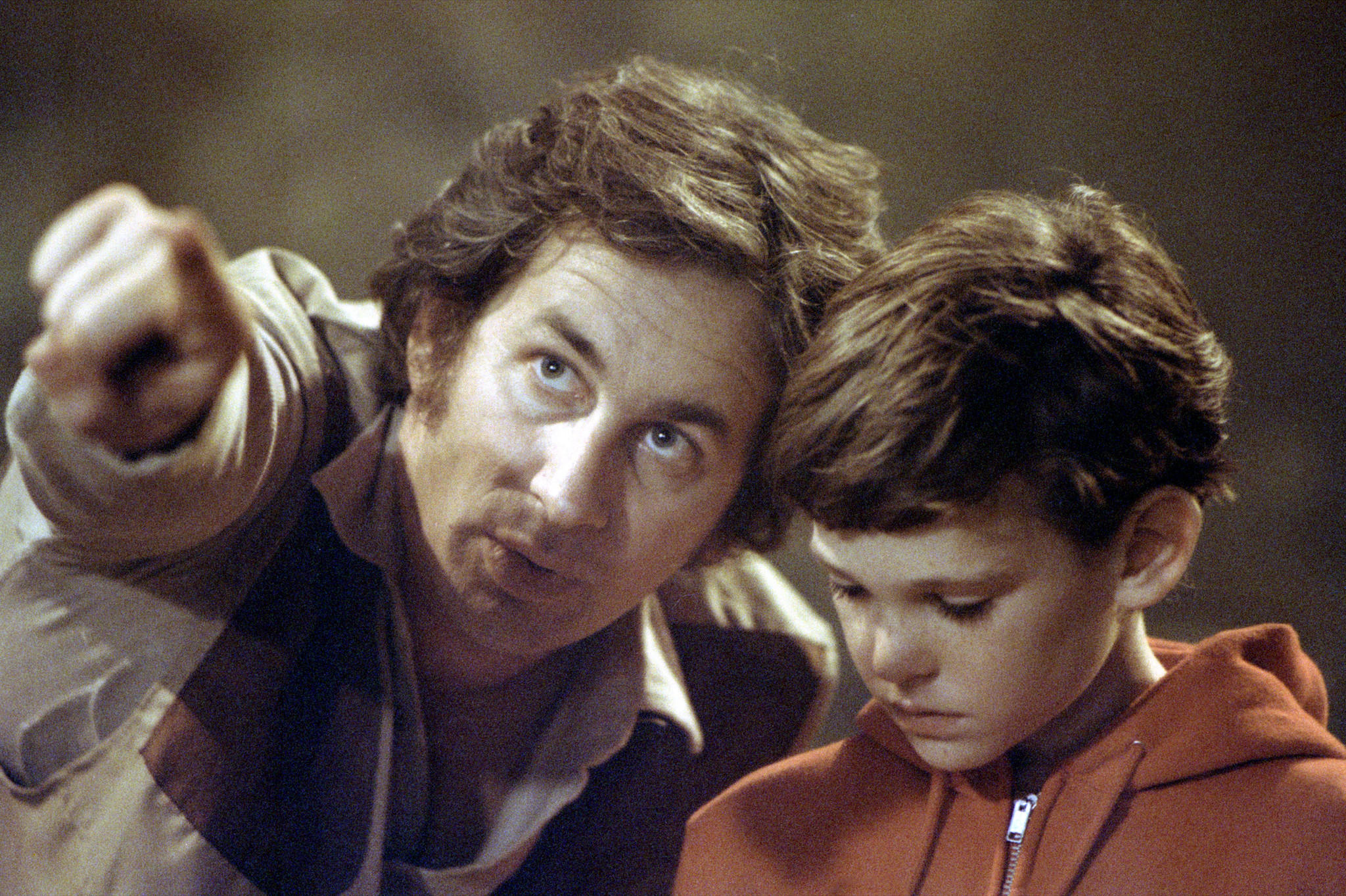 "Spielberg directs Henry Thomas, right, on the set of ""E.T. the Extra–Terrestrial"