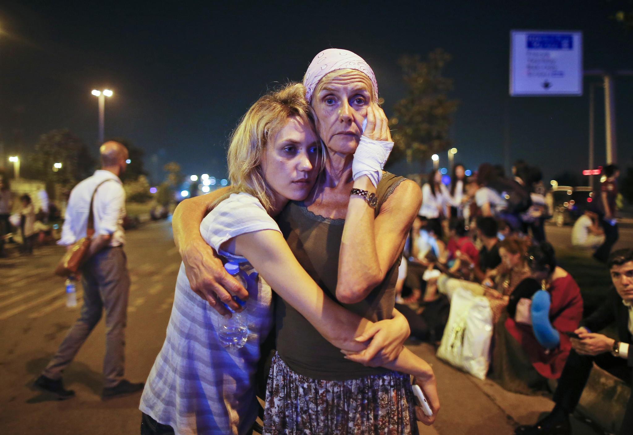 Passengers outside Istanbul's Ataturk airport in June. (Emrah Gurel / Associated Press)