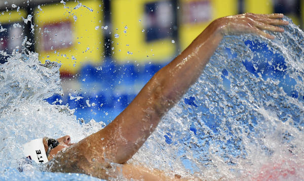 Ryan Lochte swims in the men's 200-meter individual medley preliminaries on Thursday. (Mark J. Terrill / Associated Press)