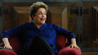 Brazil is in turmoil, an impeachment trial looms, and still, Dilma Rousseff laughs