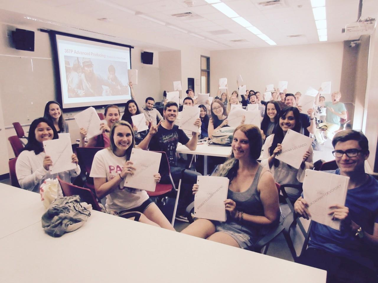 """Students in the fall 2015 Advanced Production class hold up their """"Free State of Jones"""" scripts."""