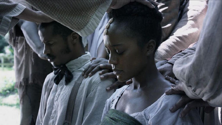 """Nate Parker, left, directed and stars as Nat Turner in """"The Birth of a Nation."""" He's seen here with Aja Naomi King. (Fox Searchlight Pictures)"""