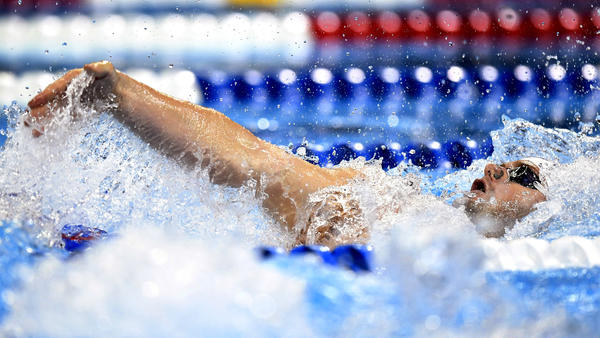 Tyler Clary swims in a men's 200-meter backstroke semifinal at the U.S. Olympic swimming trials. (Mark J. Terrill / Associated Press)