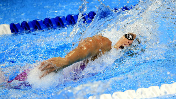 Abbey Weitzeil swims in a preliminary race for the 100-meter freestyle. (Orlin Wagner / Associated Press)