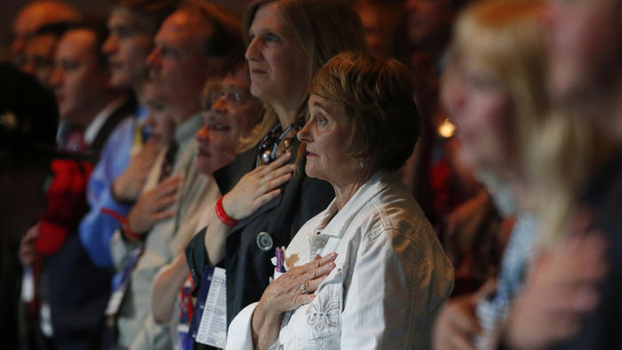 Participants stand to recite the Pledge of Allegiance at the Western Conservative Summit in Denver on Friday. (David Zalubowski / Associated Press)