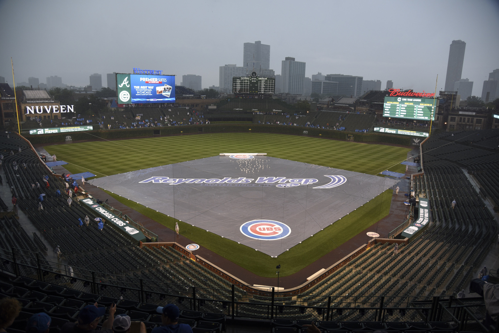 fan severely injured after jumping from wrigley bleachers