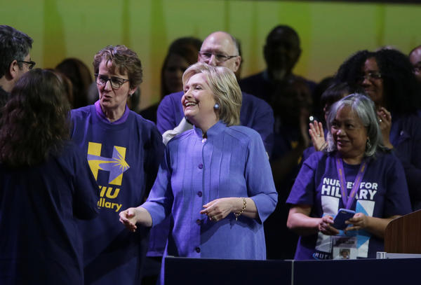 Hillary Clinton meets with SEIU members at the union's May convention in Detroit. At left is union President Mary Kay Henry. (Carlos Osorio / Associated Press)