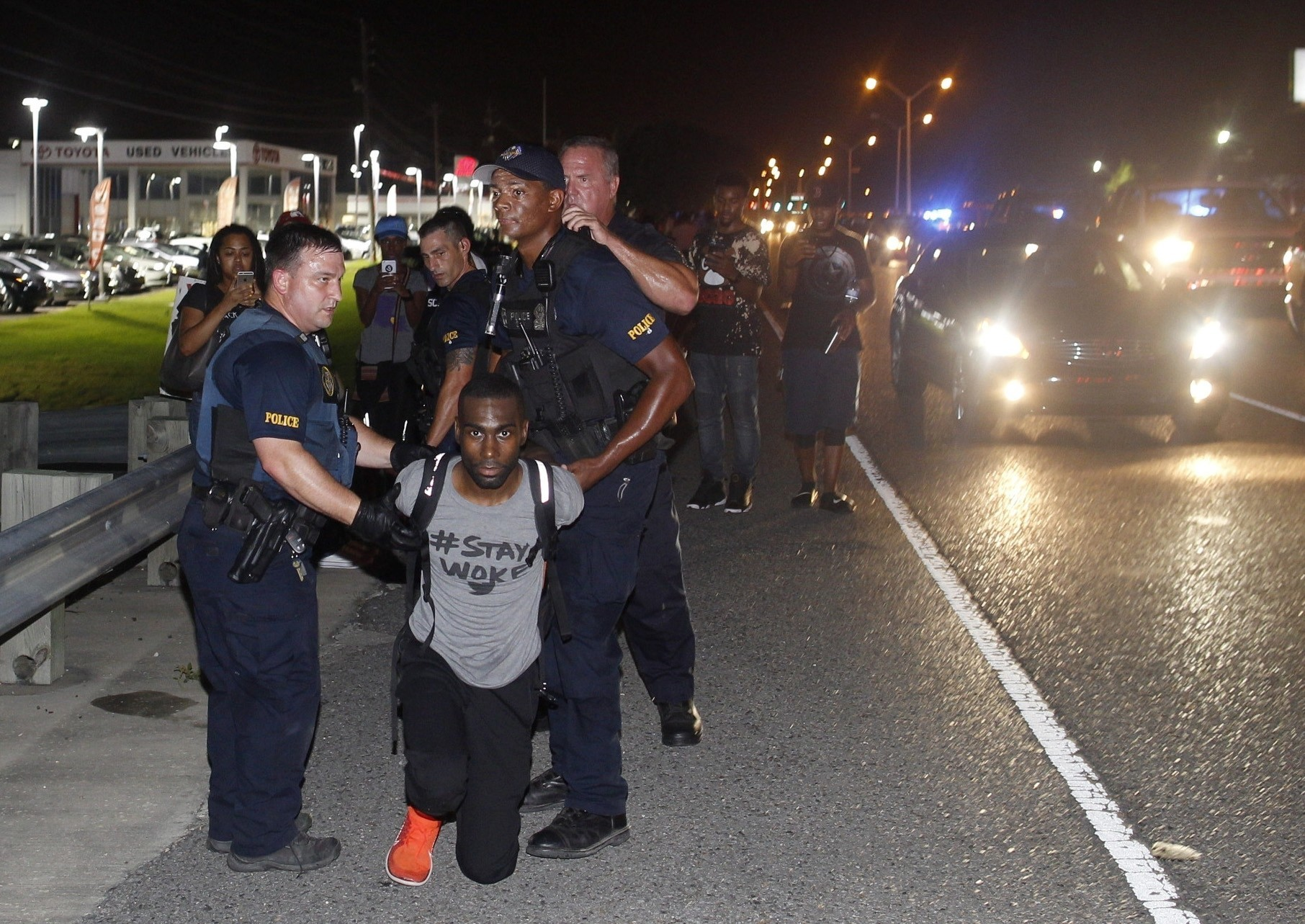 Baltimore police officers in riot gear push protestors back along - Protests Continue In Baton Rouge Hundreds Arrested Countrywide Chicago Tribune
