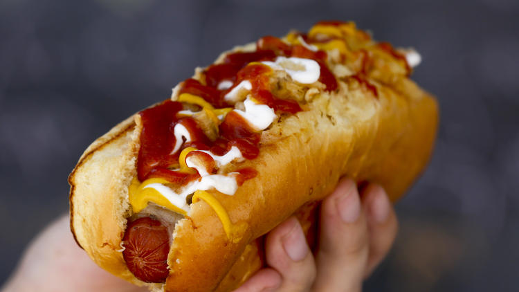 The Cali Dog, a bacon-wrapped hot dog with cheese, coleslaw and pineapple, from Cali Fresh.