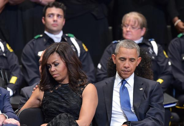 U.S. President Barack Obama and First Lady Michelle Obama attend an interfaith memorial service for the victims of the Dallas police shooting at the Morton H. Meyerson Symphony Center on July 12, 2016 in Dallas, Texas. (MANDEL NGAN/AFP/Getty Images)