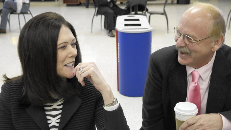 Attorney Kathleen Zellner, left, and Paul Calusinski