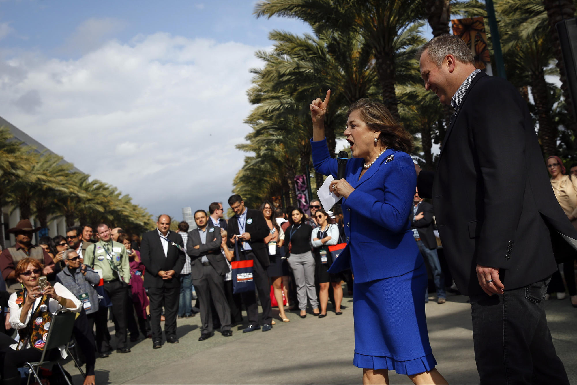 Rep. Loretta Sanchez speaks as her husband, Jack Einwechter, looks on as she campaigns for the U.S. Senate during the California Democratic Party 2015 State Convention in Anaheim.