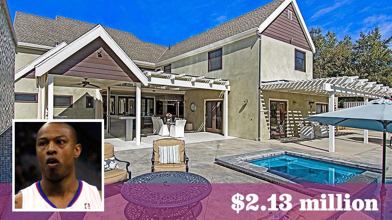 Former Clipper Caron Butler scores a home with a hoop in Woodland
