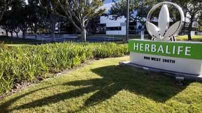 Herbalife fined $200 million, avoids charges it's a pyramid scheme