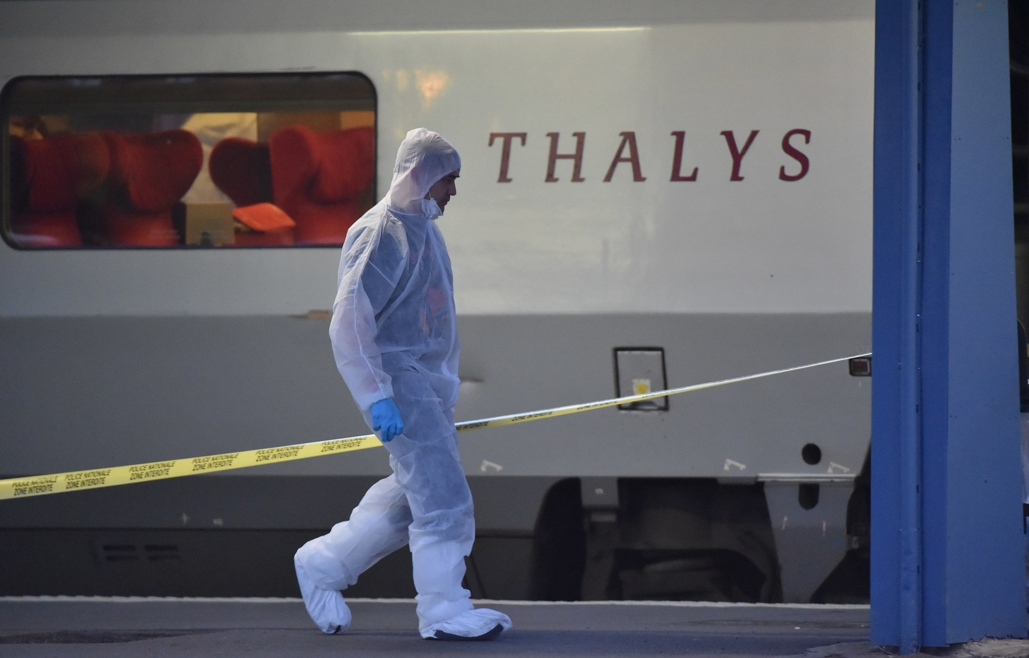 Police walk on a platform next to a Thalys train of French national railway operator SNCF in Arras, after a gunman opened fire on a train traveling from Amsterdam to Paris.