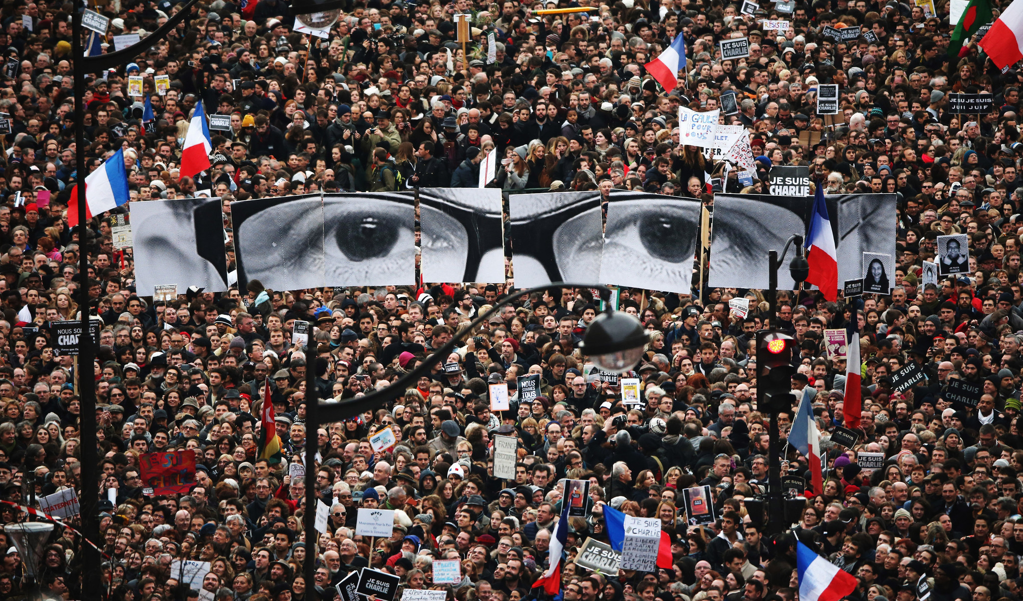 Demonstrators make their way along Boulevard Voltaire in a unity rally in Paris following terrorist attacks.